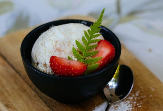 strawberries in a bowl with ice cream